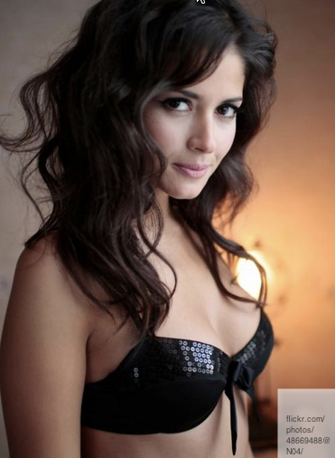 beautiful brunnette bust in black bra