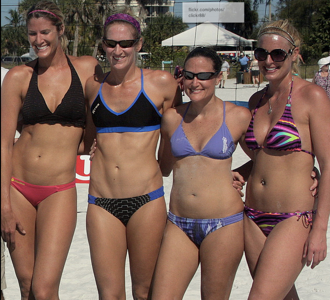 four amazing athletic girls in bathing suits