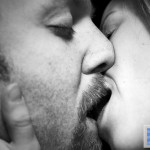 kissing black and white middle aged