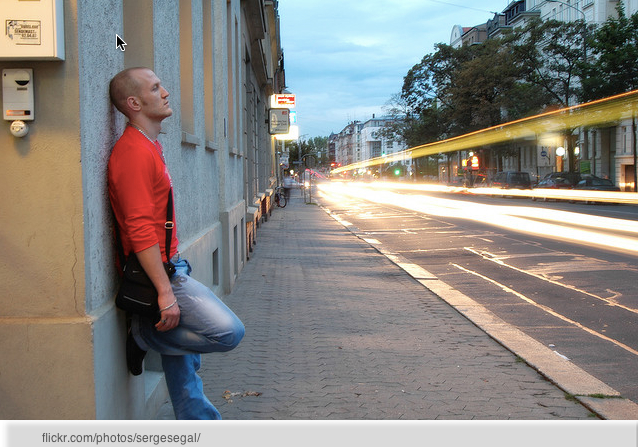 guy leaning on wall given up on finding a girlfriend